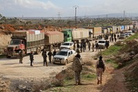 For first time in months, aid convoys reach four besieged Syrian towns