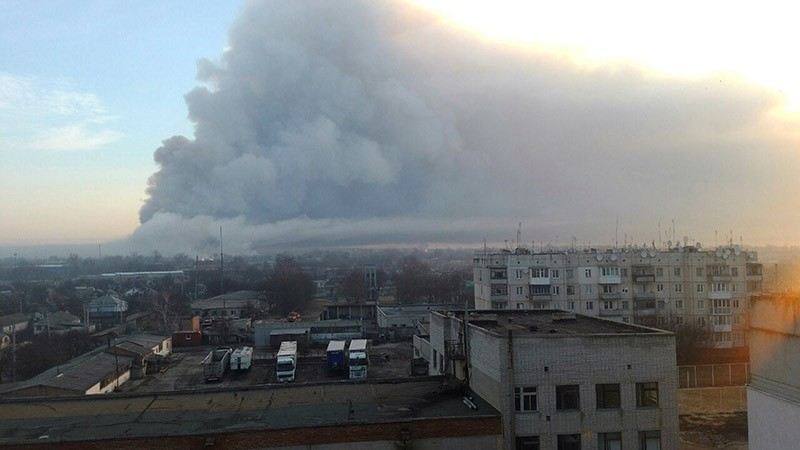 Smoke rises over a warehouse storing tank ammunition at a military base in the town of Balakleya, Kharkiv region, Ukraine, March 23, 2017. (State Emergency Service of Ukraine/Handout via Reuters)