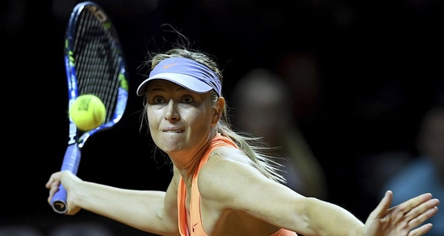 Russian tennis player Maria Sharapova returns the ball to Kristina Mladenovic from France during the Porsche Tennis Grand Prix in Stuttgart, Germany, Saturday, April 29, 2017. AP Photo