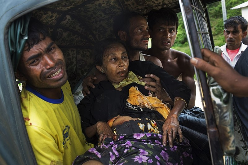 An injured elderly woman and her relatives rush to a hospital on an autorickshaw, near the border town of Kutupalong, Bangladesh, Monday, Sept. 4, 2017. (AP Photo)