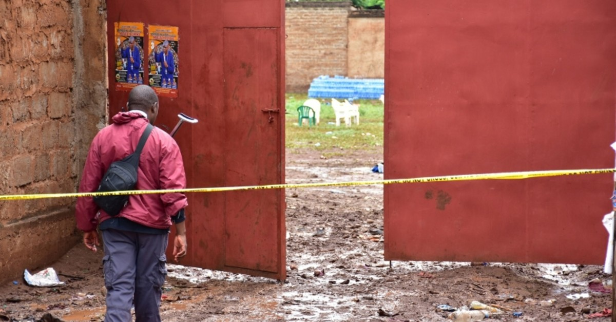 A plain police protects the main gate of Majengo ground township of Moshi in Kilimanjaro region, north Tanzania, on February 2, 2020  after 20 people were killed and and 16 injured in stampede yesterday evening at Majengo open ground (AFP Photo)