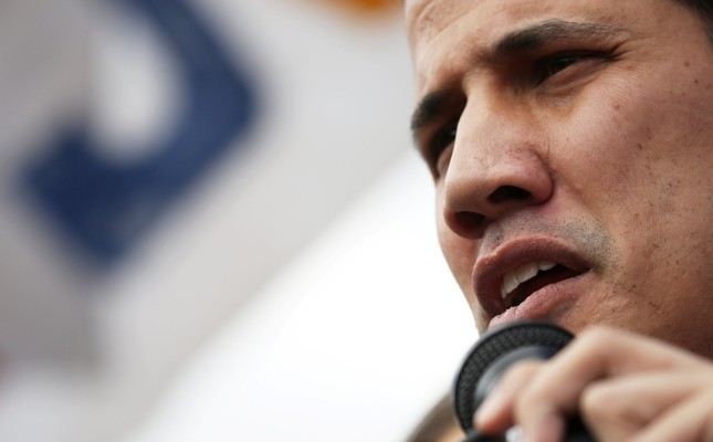 Venezuela's opposition leader Juan Guaido speaks during a rally with members of the Venezuela's National Assembly regarding an amnesty law project for members of the military, in Caracas, Venezuela, January 26, 2019. (Reuters Photo)