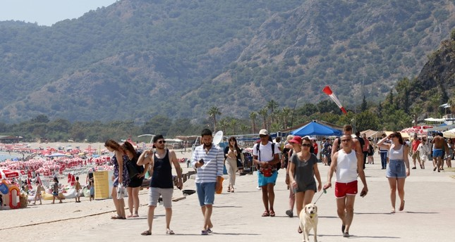 Holidaymakers on a beach in the seaside city of Fethiye in the Muğla province, June 5, 2019.
