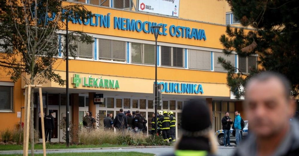 Police officers stand guard near the site of a shooting in front of a hospital in Ostrava, Czechia, Dec. 10, 2019. (Reuters Photo)
