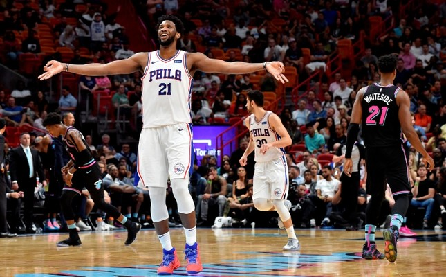 Philadelphia 76ers center Joel Embiid (21) reacts after making a 3-point basket over Miami Heat's Hassan Whiteside (21) during the 2nd half at American Airlines Arena. Furkan Korkmaz (30) is in the background. (Steve Mitchell-USA TODAYSports/Reuters)
