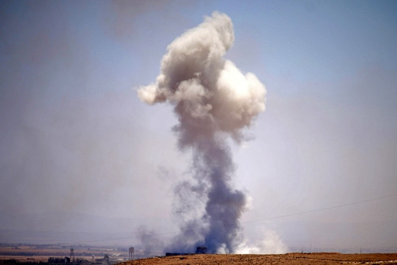 Smoke rises above Syrian opposition-held areas of the province of Daraa during reported airstrikes by Assad regime forces, July 8, 2018. (AFP Photo)