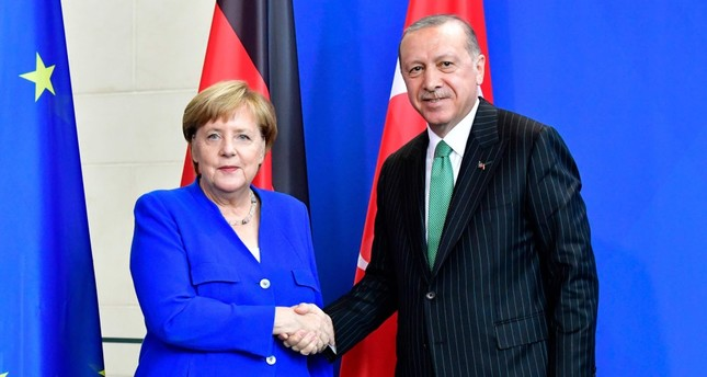 President Recep Tayyip Erdoğan and German Chancellor Angela Merkel shake hands at a joint press conference after bilateral talks in Berlin, Sept. 28.