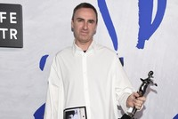 Designer Raf Simons of Calvin Klein scored a rare double win at fashion's glittery awards ceremony on Monday, winning both womenswear and menswear honors at the annual Council of Fashion Designers...