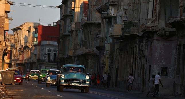 Classic cars drive down a road in Havana, Cuba (EPA Photo)