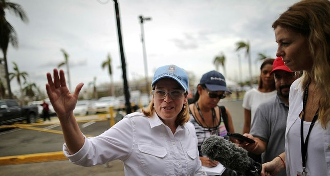 Mayor of San Juan Carmen Yulin Cruz talks with journalists outside the government center at the Roberto Clemente Coliseum days after Hurricane Maria, in San Juan, Puerto Rico September 30, 2017. (Reuters Photo)