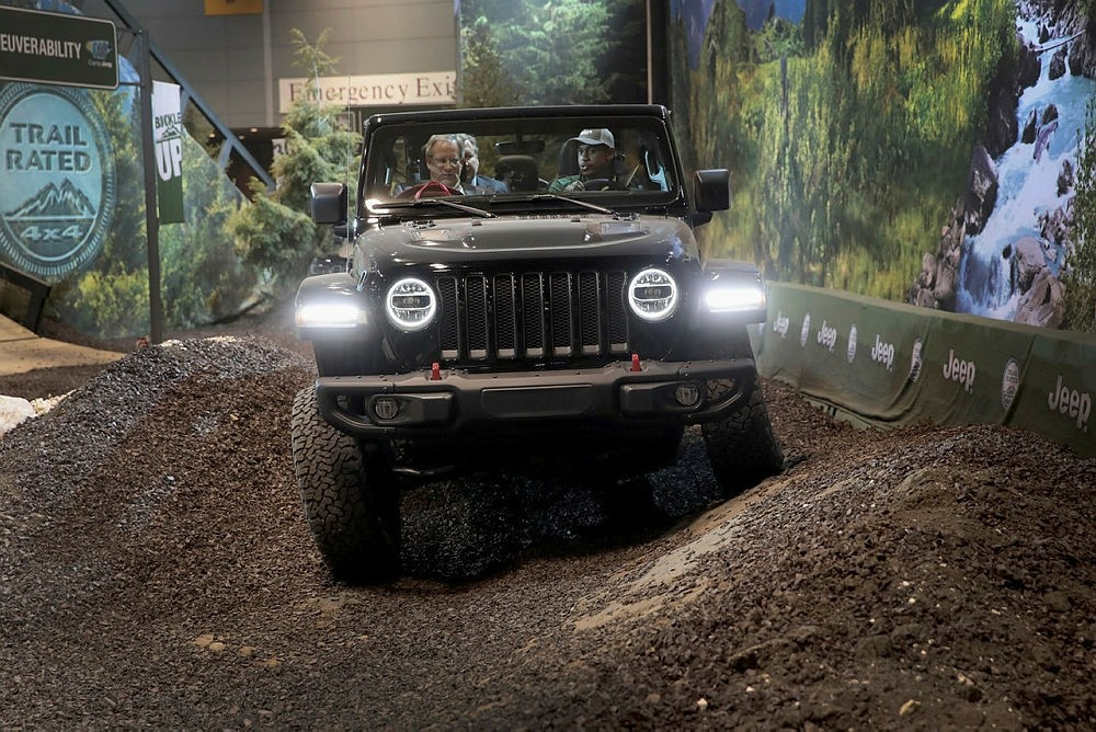 Guests drive a Jeep Wrangler Rubicon on a simulated off-road course at the Chicago Auto Show.