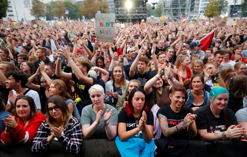 People have a rave in front of the Karl-Marx statute after the ,We Are More, concert to say 'No' to the far right on September 3, 2018 in Chemnitz, eastern Germany. (REUTERS Photo)