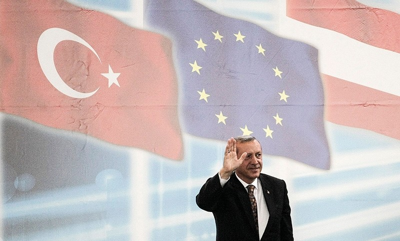 ) In this file photo taken on June 19, 2014, then-PM Recep Tayyip Erdou011fan gestures prior to give a speech during an event to mark the 10th anniversary of the Union of European Turkish Democrats UETD at the Albert Schultz Hall in Vienna (AFP Photo)