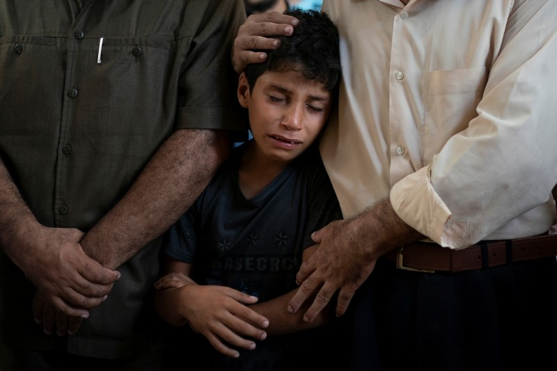 Mahmoud Abdel-al, 11, cries during the funeral of his twin brother Shady Abdel-al in Beit Lahiya, Gaza Strip, Saturday, Sept. 15, 2018. (AP Photo)
