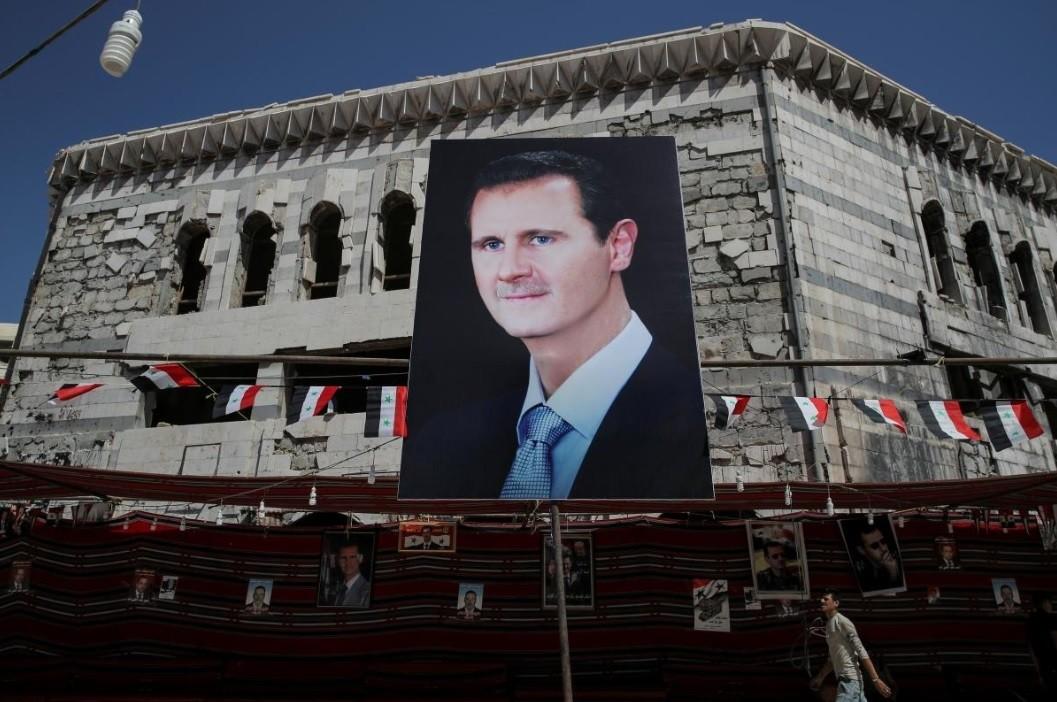 A man walks past a banner depicting Bashar al-Assad in Douma, outside Damascus, Syria, September 17, 2018. (Reuters Photo)