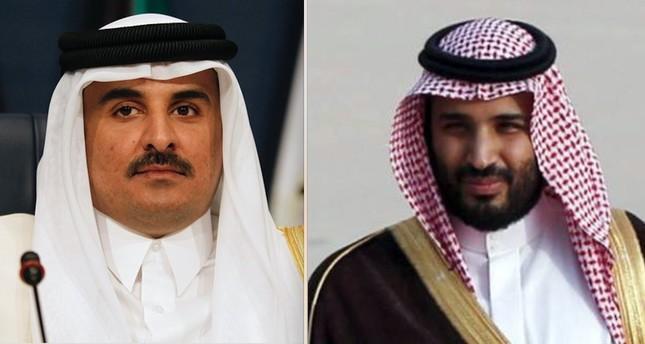 Qatari Emir Tamim bin Hamad Al Thani (L) and Saudi Crown Prince Mohammed Bin Salman (R).