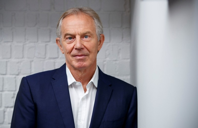 Former British Prime Minister Tony Blair poses for a photograph ahead of an interview with AFP in central London on July 17, 2018.
