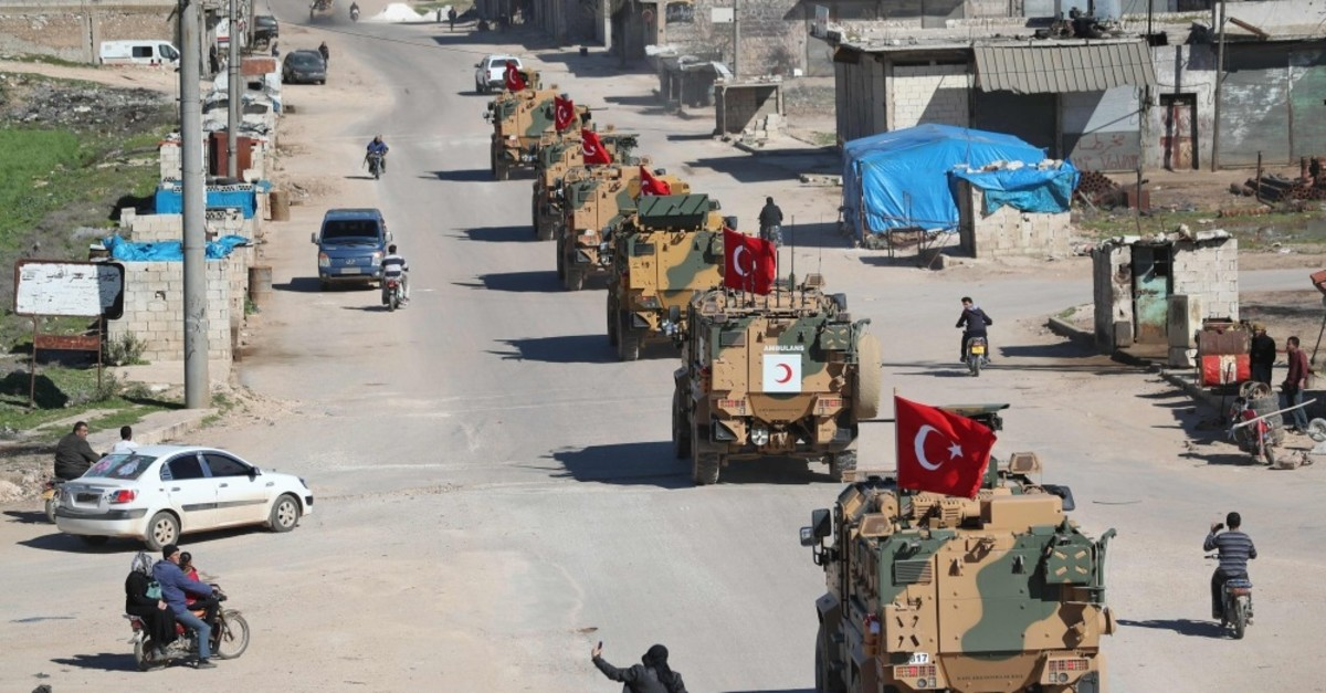 A convoy of armored Turkish military vehicles on patrol along a road in the de-militarized zone in Syria's northern Idlib province, March 8, 2019.