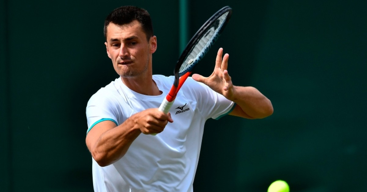 Australia's Bernard Tomic returns against France's Jo-Wilfried Tsonga during their men's singles first round match at the 2019 Wimbledon Championships in southwest London, on July 2, 2019. (AFP Photo)
