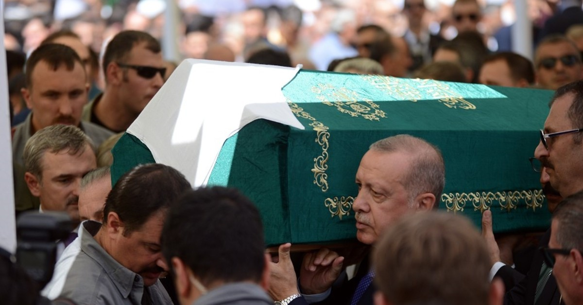 President Recep Tayyip Erdou011fan carries the coffin of u015eule Yu00fcksel u015eenler after funeral prayers at Eyu00fcpsultan Mosque in Istanbul, Aug. 29, 2019.