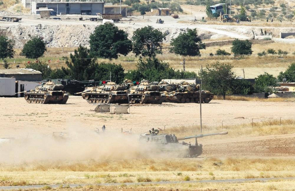 A Turkish military vehicle leaves its base in Suruu00e7, u015eanlu0131urfa province near the Syrian border, June 26, 2015.