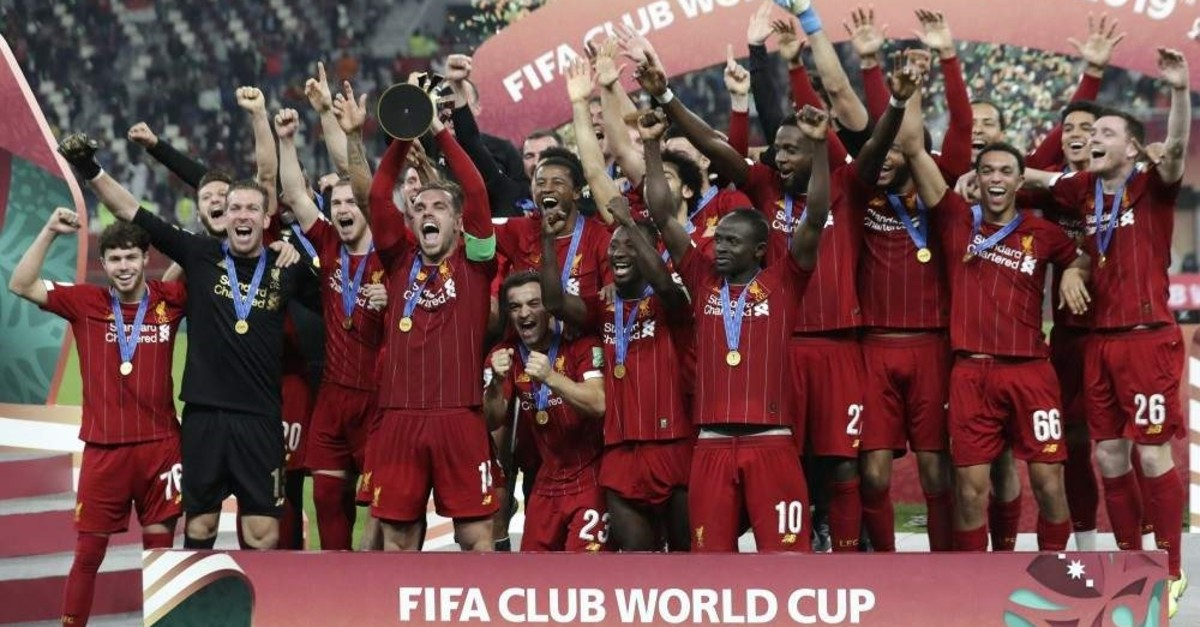 Liverpool players celebrate after winning the Club World Cup final match against Flamengo in Doha, Dec. 21, 2019. (AP Photo)