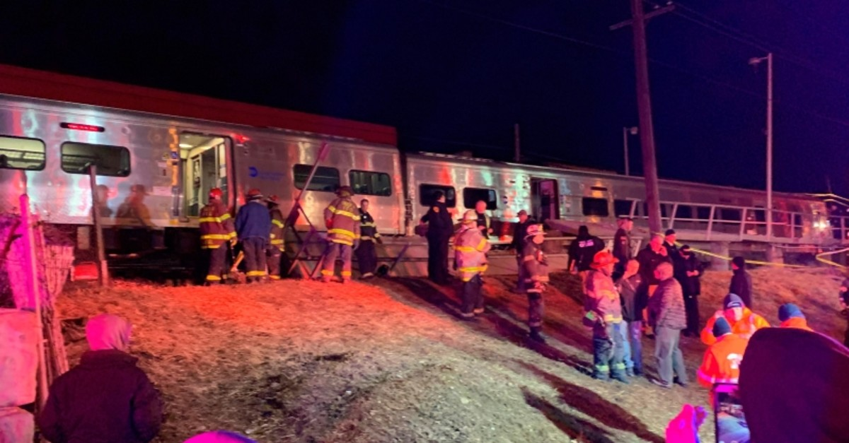 First responders work the scene of a collision involving a Manhattan-bound commuter train and a vehicle in Westbury, N.Y., Tuesday, Feb. 26, 2019 (AP Photo)