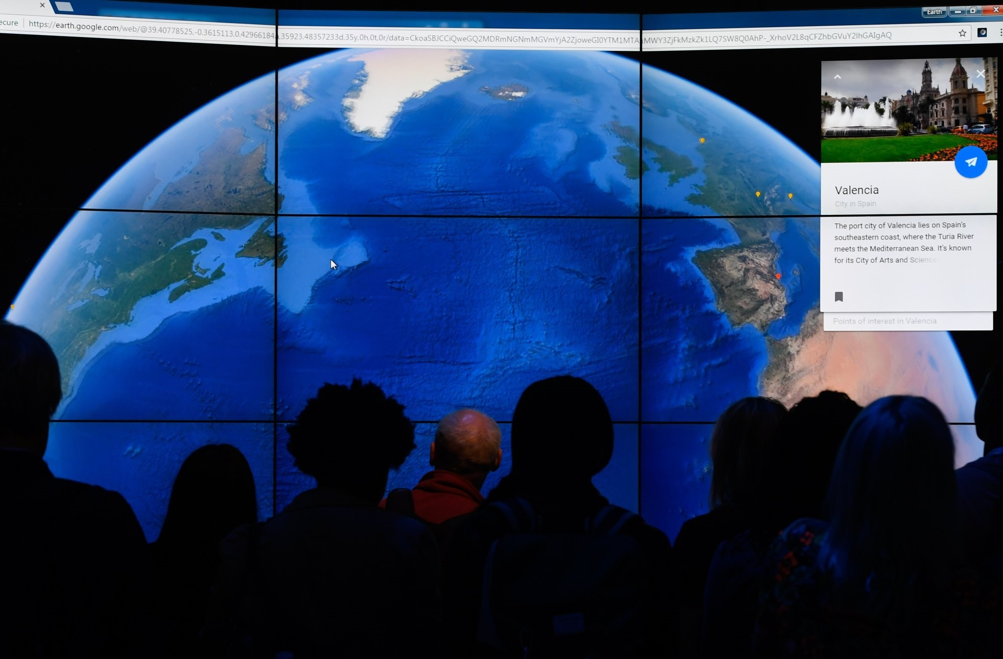 People look at a Google Earth map on a screen as Google Earth unveils the revamped version of the application April 18, 2017 at a event at New York's Whitney Museum of Art. (AFP Photo)