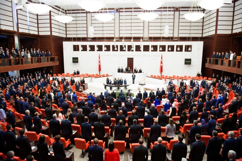 Members of the Parliament observe a moment of silence before the oath-taking ceremony. (IHA Photo)