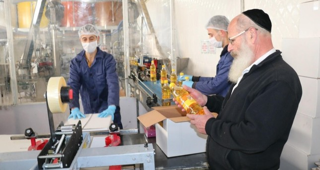 Israeli Rabbi Froilich examined the nut oil production process at a Turkish firm in Turkey's Aegean province Afyon to ensure compliance with the dietary requirements of the Jewish people during Passover