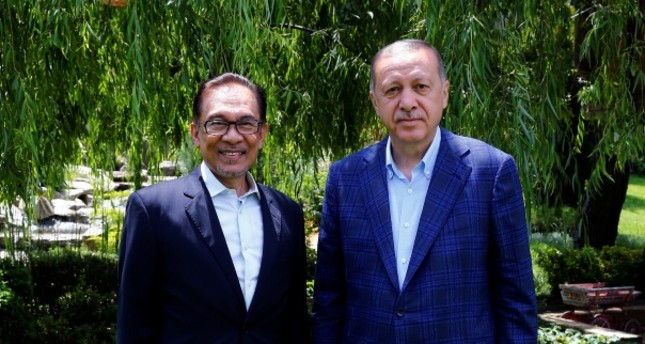 President and ruling Justice and Development Party's (AK Party) leader Recep Tayyip Erdoğan, right, and Malaysia's ruling coalition leader PM Anwar Ibrahim pose for a photo before a meeting in Istanbul, Wednesday, June 20, 2018.