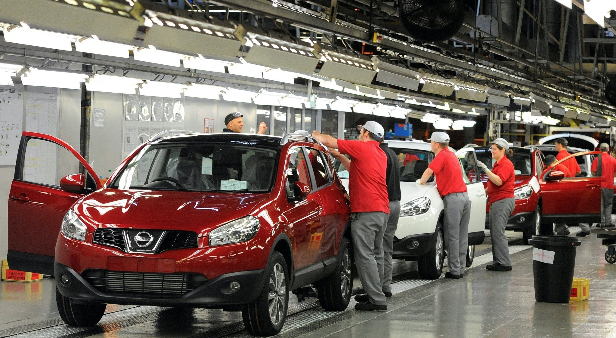 A worker is seen completing final checks on the production line at the Nissan car plant in Sunderland, northern England, June 24, 2010.