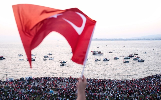 A man waves a Turkish flag during a rally at Gündoğdu Sqaure in İzmir, protesting the failed coup attempt orchestrated on July 15, 2016 by the Gülenist Terror Group, Aug. 4, 2016.