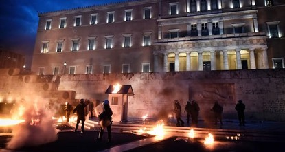 pProtesters threw Molotov cocktails and rocks at the Greek parliament Thursday while the lawmakers were inside debating new austerity measures./p  pHours ahead of a vote on a new memorandum that...