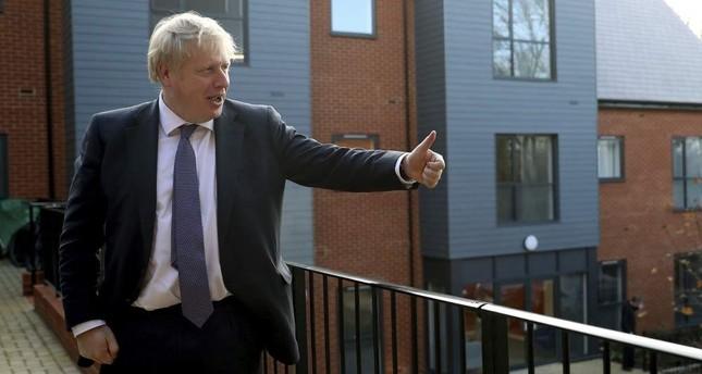 Britain's Prime Minister Boris Johnson visits a veterans center as part of his general election campaign, Salisbury, Dec. 3, 2019. AP Photo