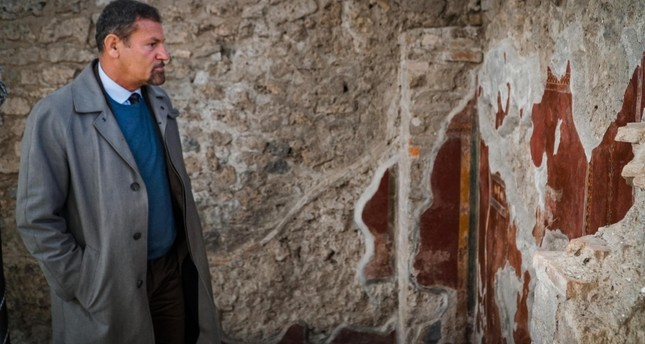 The director of the archaeological park of Pompeii, Massimo Osanna shows the restoration done to the frescoes of the House of the Gladiators, known as Schola Armaturarum, at the Pompeii archaeological site, near Naples, Italy,3 Jan 2019 EPA Photo