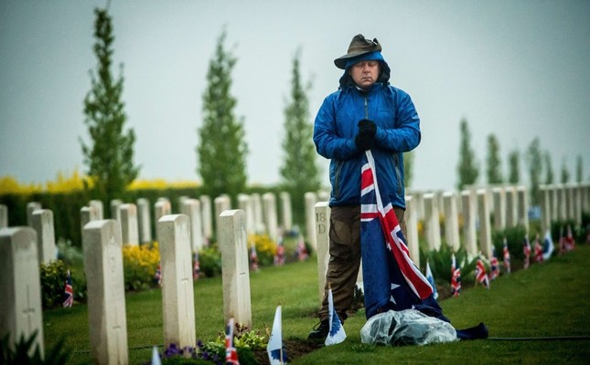 A man pays his respect to fallen Australian soldiers died in the Battle of Gallipoli during a dawn ceremony marking the 100th anniversary of Anzac Day on April 25, 2015.