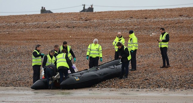 Britain's Border Force carry an intercepted migrant dinghy off the Kent coast, Britain Dec. 31, 2018, in this picture obtained from social media. (Twitter/Susan Pilcher via Reuters)