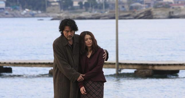 """Koji Yakusho (L) and Kyoko Koizumi in Kurosawa's film """"Tokyo Sonata"""" (2008)."""