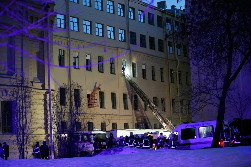 Russian Emergency employees work at the scene of the collapse building of the Saint Petersburg National Research University of Information Technologies, Mechanics and Optics in St. Petersburg, Russia, Saturday, Feb. 16, 2019(AP Photo)