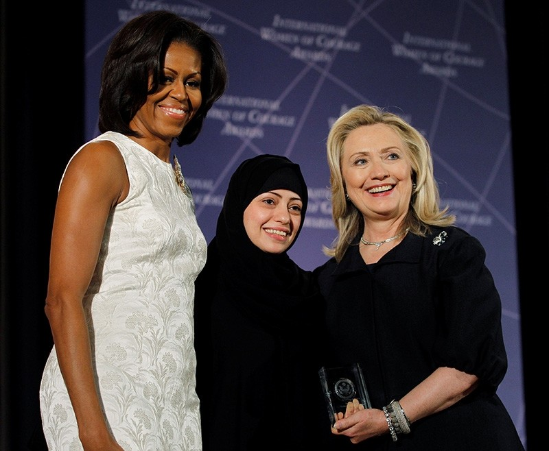 U.S. Secretary of State Hillary Clinton and First lady Michelle Obama (L) congratulate Samar Badawi of Saudi Arabia during the State Department's 2012 International Women of Courage Award winners ceremony in Washington March 8, 2012. (Reuters Photo)
