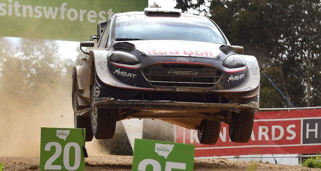 Sebastien Ogier of France speeds over a brow on the final day of the World Rally Championship.