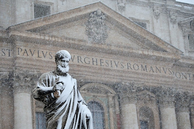 The statue of Saint Peter is pictured during a heavy snowfall in Saint Peter's Square at the Vatican Feb. 26, 2018. (Reuters Photo)
