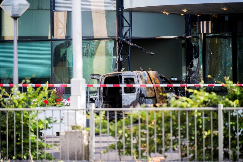 A van is seen burned out after crashing into the glass facade of the head office of Dutch newspaper De Telegraaf in what police said was a deliberate action in Amsterdam, Netherlands June 26, 2018. (Reuters Photo)