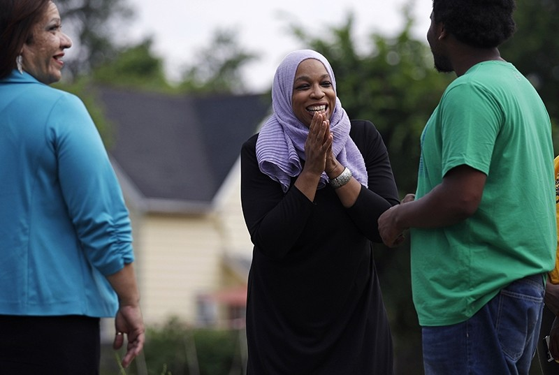 Attorney Tahirah Amatul-Wadud, who is challenging incumbent U.S. Rep. Richard Neal, D-Mass., center, during a visit to a community garden while campaigning in the Mason Square neighborhood of Springfield, Mass. on June 18, 2018. (AP Photo)