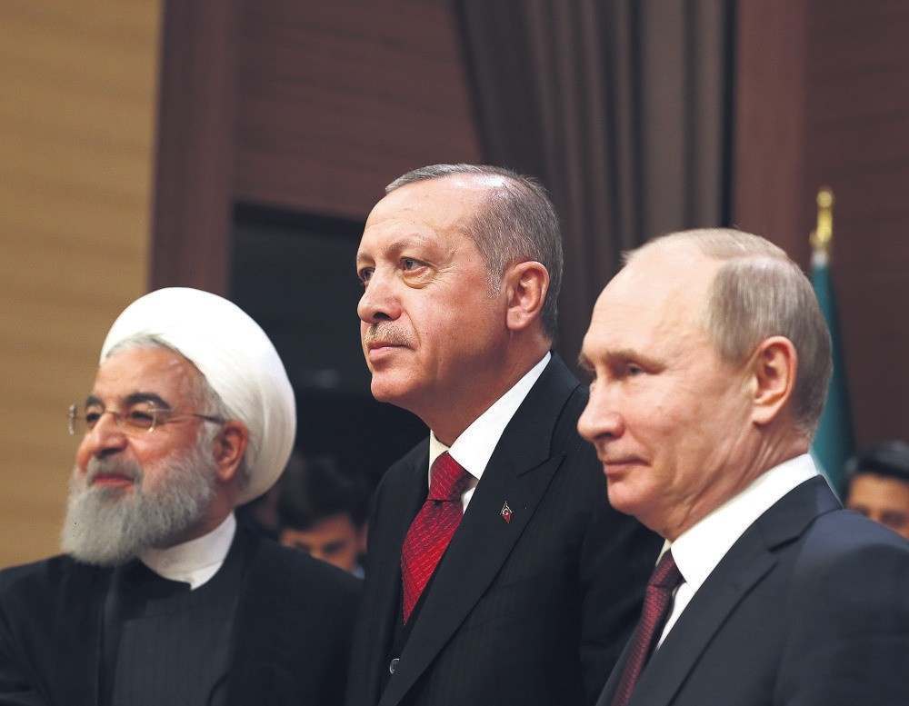 Iranian President Hassan Rouhani, (L), Russian President Vladimir Putin (R) and President Recep Tayyip Erdou011fan reaffirmed their commitment to Syria's territorial integrity during a summit in Ankara yesterday.