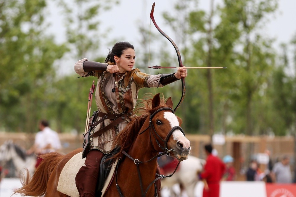 Female archers displayed their skills at Friday's events while riders performed stunts. (AA Photo)