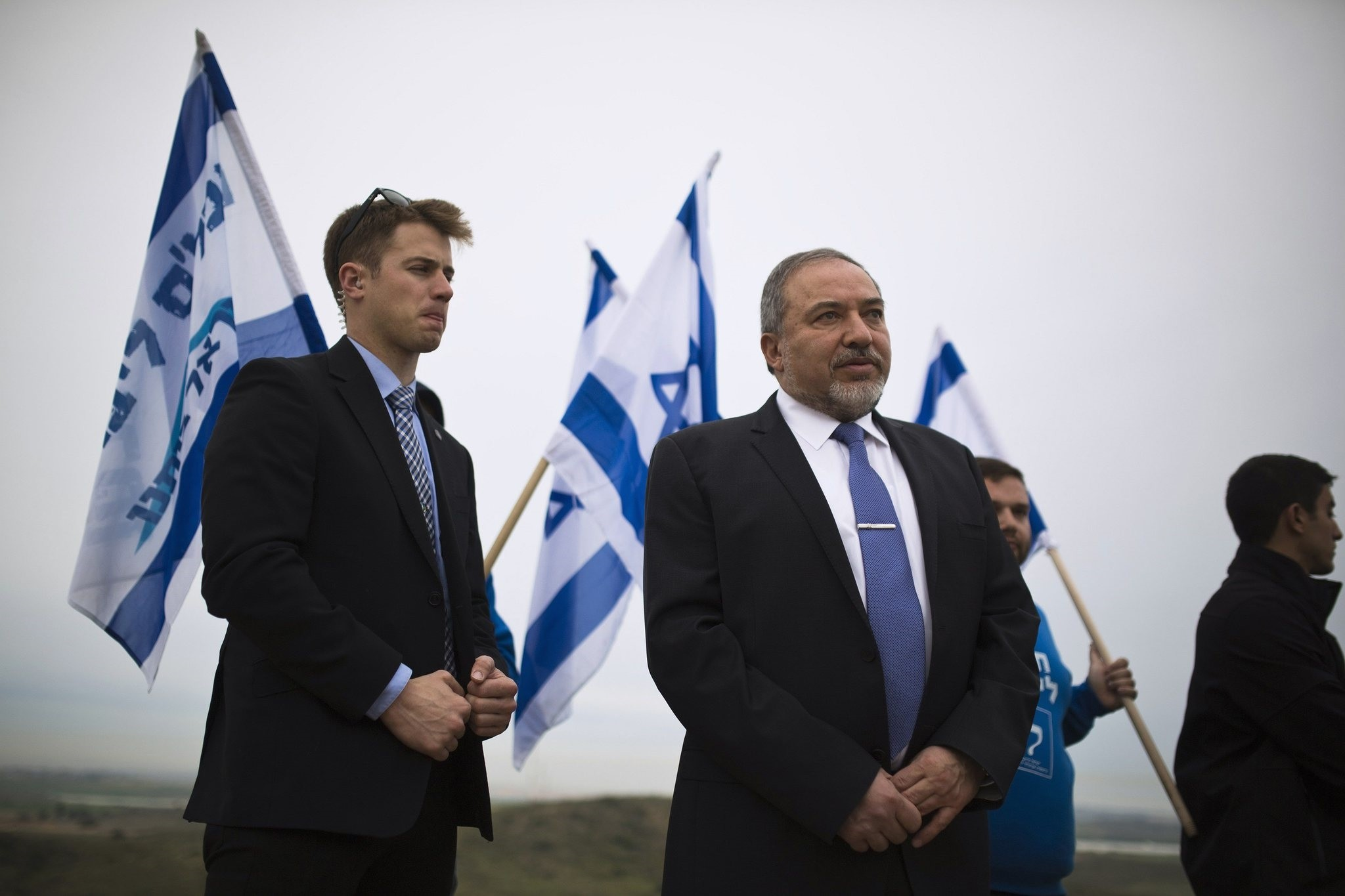 Avigdor Lieberman stands on a hill overlooking the Gaza Strip, as he campaigns in the southern town of Sderot February 23, 2015. (REUTERS Photo)