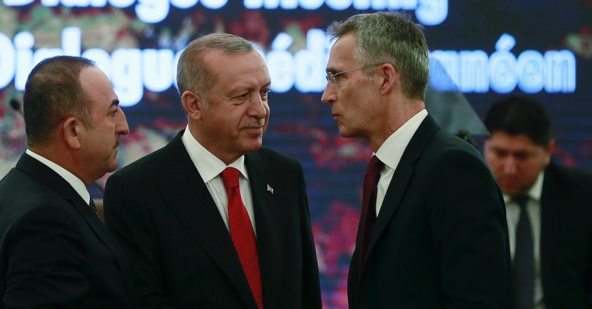 President Recep Tayyip Erdou011fan, (C), and Foreign Minister Mevlu00fct u00c7avuu015fou011flu, (L), speak with NATO Secretary General Jens Stoltenberg during a meeting of NATOu2019s Mediterranean Dialogue, in Ankara, May 6, 2019.