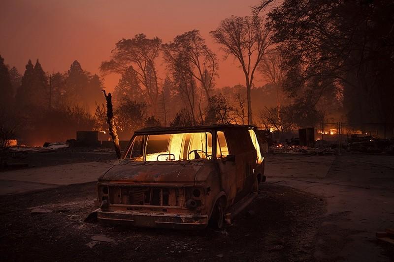 Flames burn inside a van as the Camp Fire tears through Paradise, Calif., on Thursday, Nov. 8, 2018. (AP Photo)
